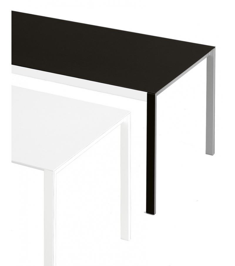 Thin k extendable table in aluminum kristalia milia shop for Table in table